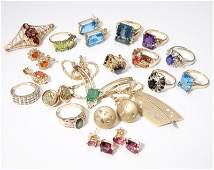 A large group of gem and gold jewelry items