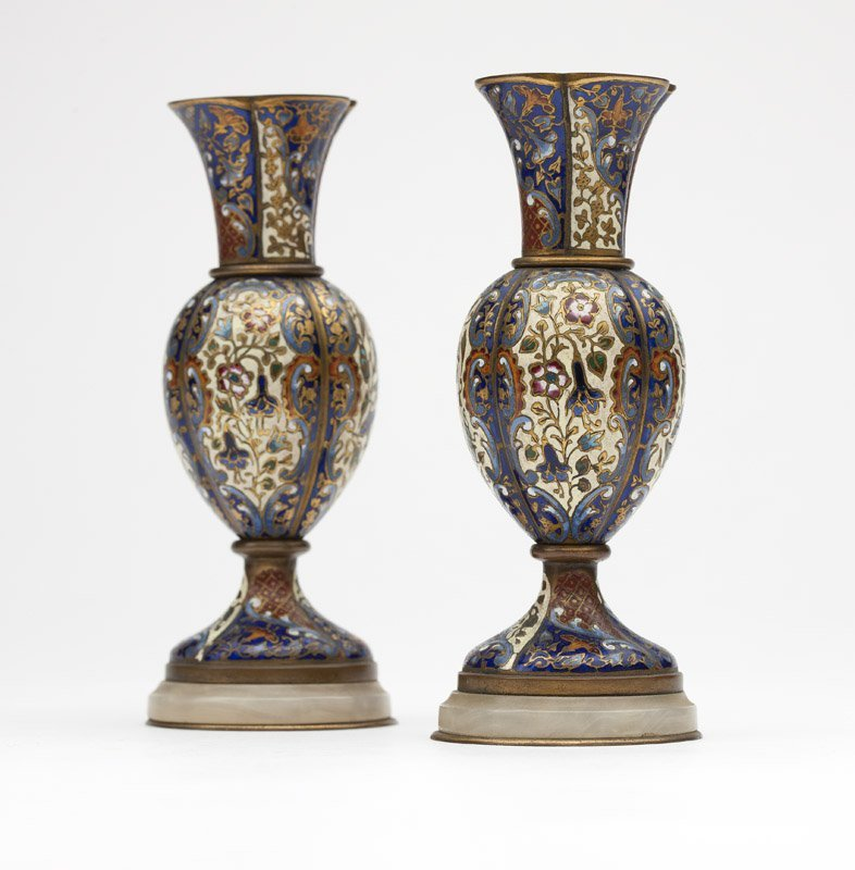 A pair of champleve enamel candlesticks
