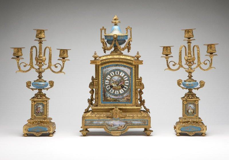 A French gilt bronze & porcelain clock garniture