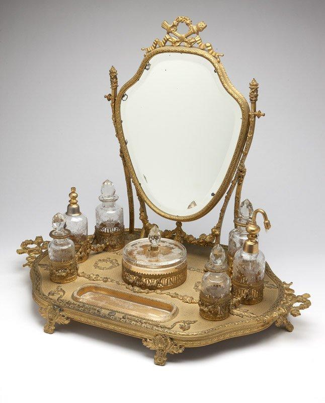 A gilt bronze & glass dressing set