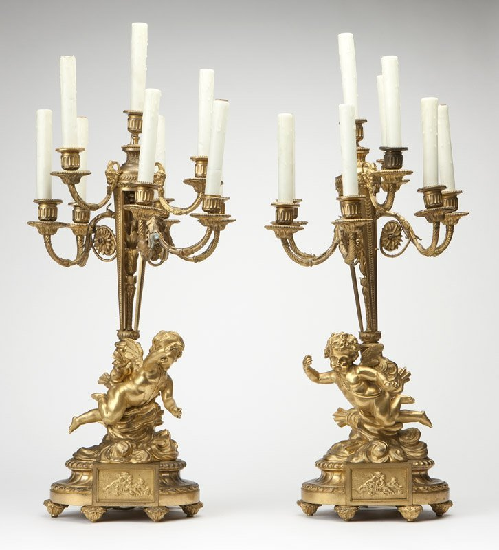 A pair of French gilt bronze candelabra, Barbedienne