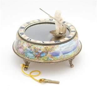 A Juvenia silver, gilt metal & enamel mystery clock