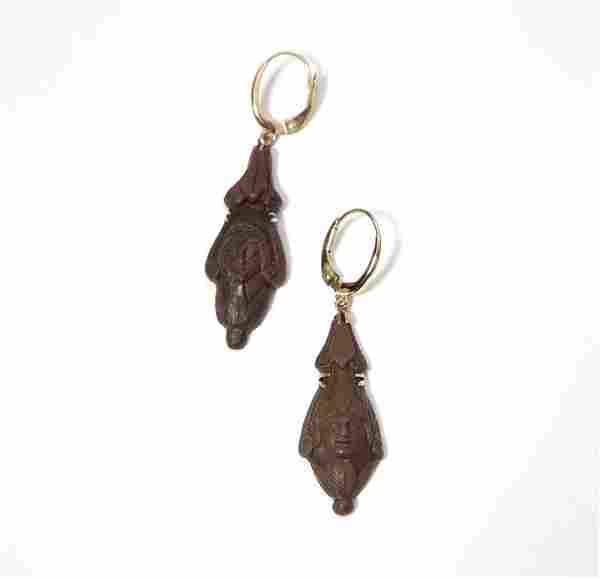 A pair of carved lava ear pendants