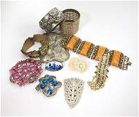 A group of antique and vintage costume jewelry