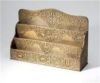 A Tiffany Studios ''Zodiac'' gilt bronze letter rack