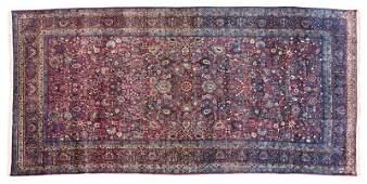 A Persian Kermanshah room-sized rug