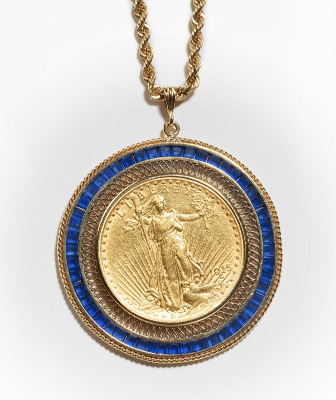 A blue glass and gold coin pendant necklace