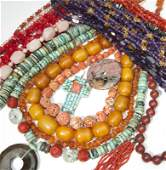 A large collection of beads and bakelite jewelry