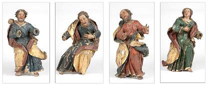 Four Continental carved polychrome and gilt painted