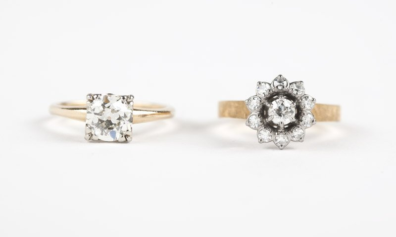 A collection of two diamond and gold rings