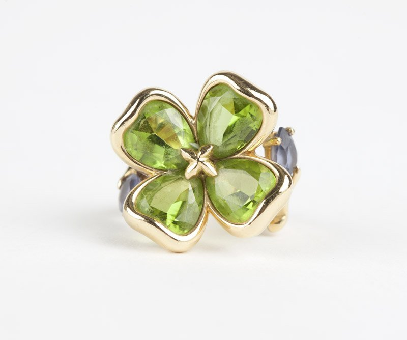 A gold peridot and tanzanite clover ring, Chanel