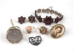 A group of various gem gold and metal jewelry