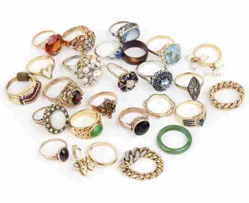 A collection of gem and gold rings