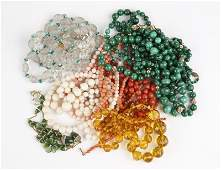 A large collection of beaded necklaces