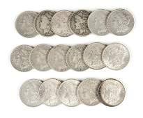 Group of 17 US Morgan Silver Dollars