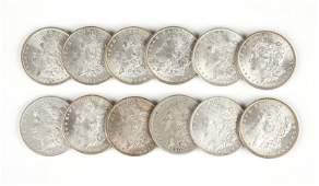 Group of 12 US Morgan Silver Dollars