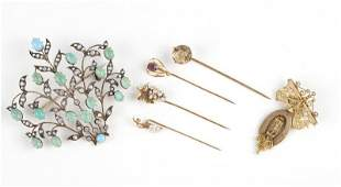 A collection of antique brooches and pins