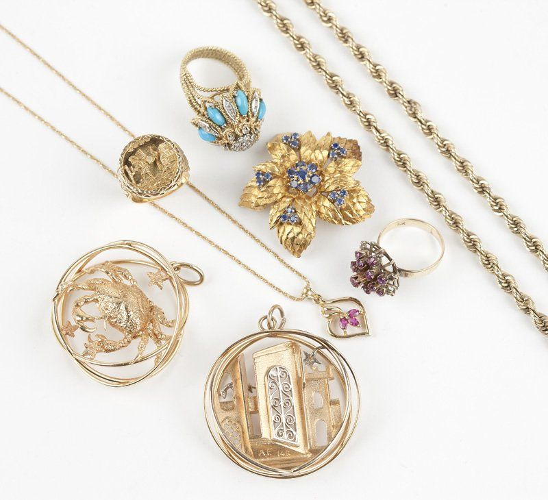 A collection of gold jewelry items