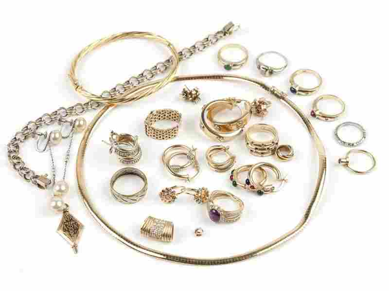 A collection of diamond, gem and gold jewelry