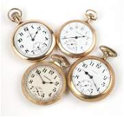 A group of four American pocket watches