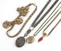 A group of antique silver and costume jewelry