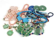 A large group of bead and costume jewelry