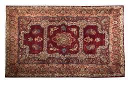 A large Persian Sarouk rug