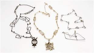 A group of abstract jewelry