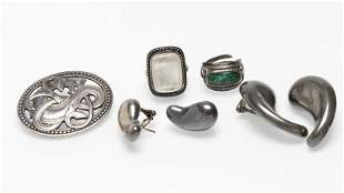 A group of five silver jewelry items
