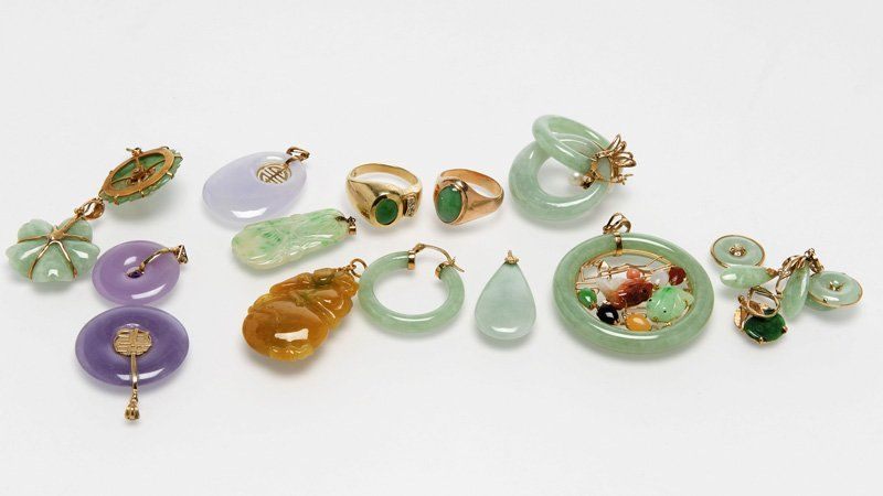 A large group of jade and gold jewelry