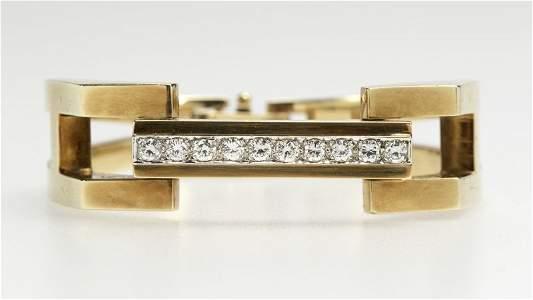 A gold and diamond sectional bangle