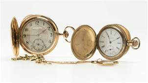 A group of pocket watches and fobs