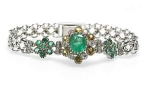 A gem-set, diamond and white gold chain bracelet