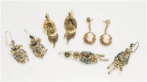 A group of various metal antiquestyle earrings