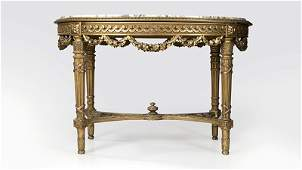 A French Louis XVIstyle carved giltwood table