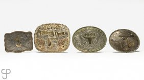 A Group Of Four Large Belt Buckles