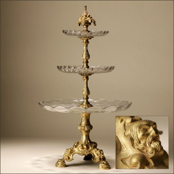 1005: A ROCOCO STYLE GILT-METAL TIERED SERVER