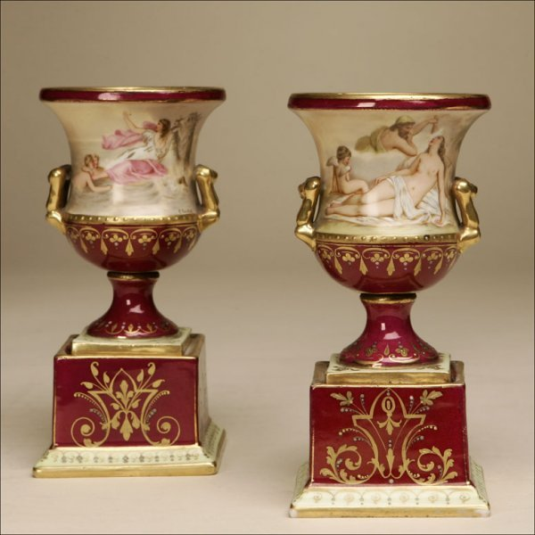 1015: A PAIR OF POLYCHROME-DECORATED URNS