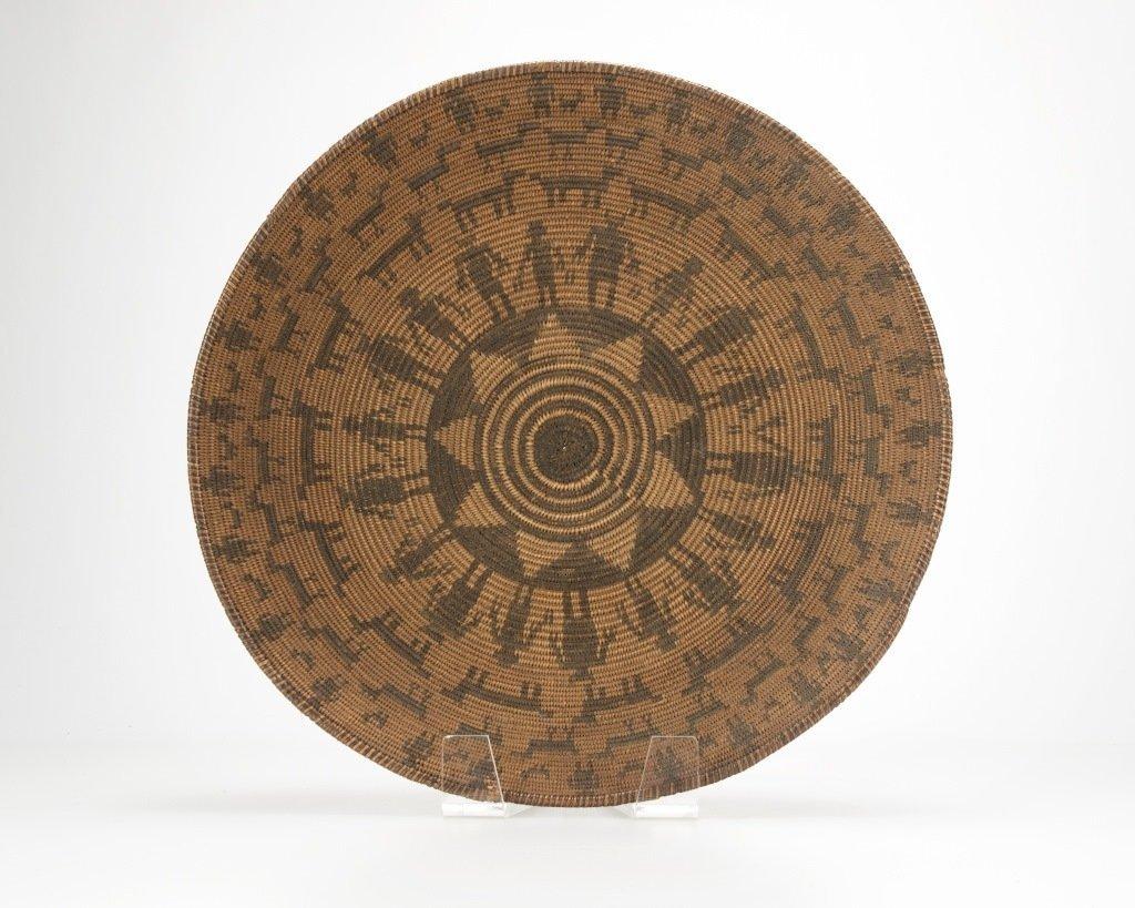 An Apache figural basket
