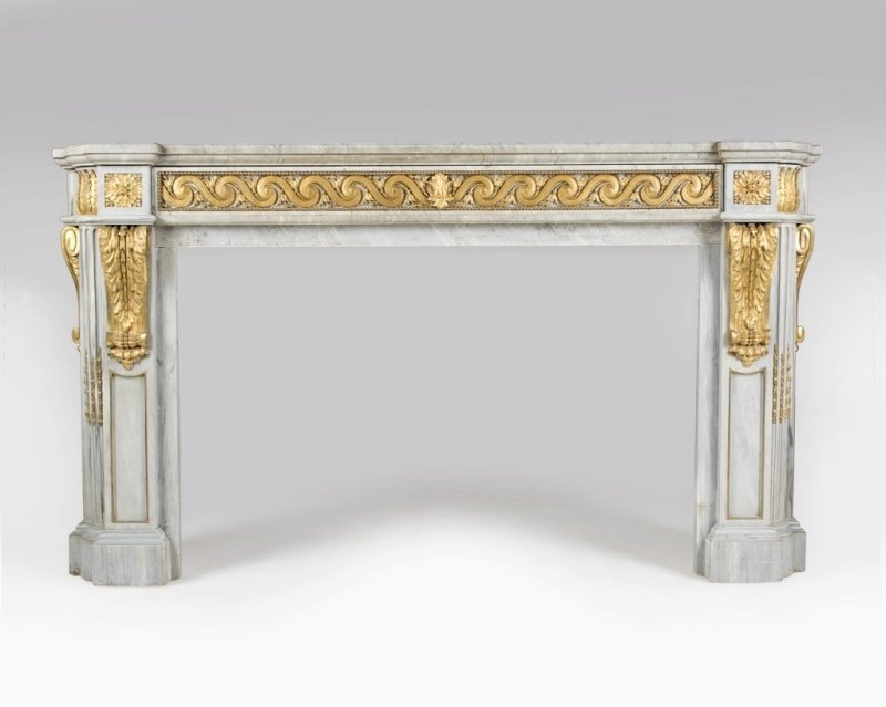 A gilt bronze-mounted marble fireplace surround