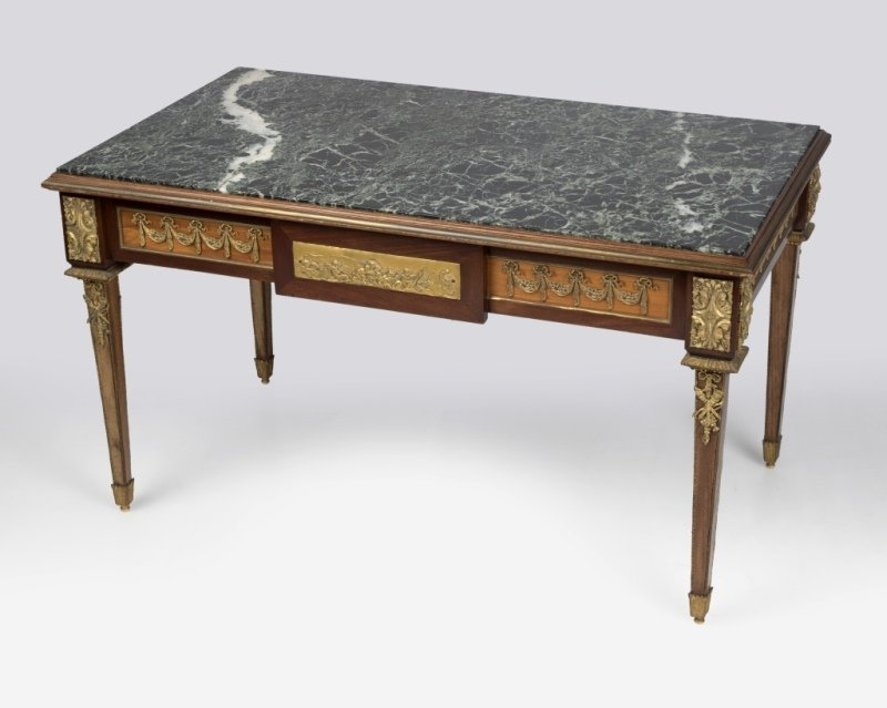 A Louis XVI-style cocktail table