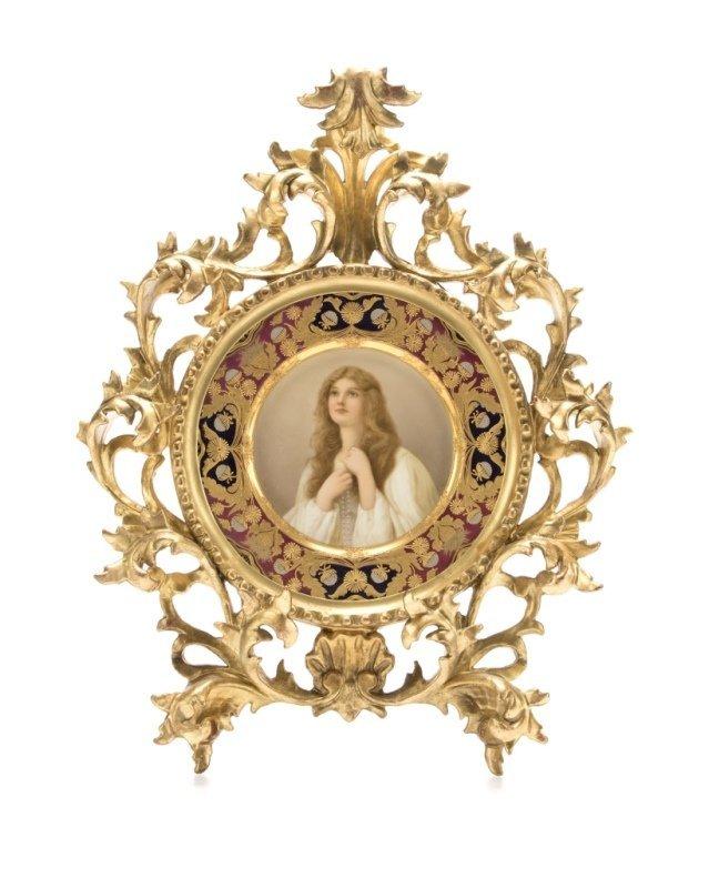 A framed Royal Vienna-style portrait plate