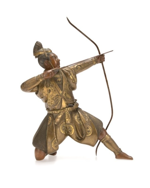 A bronze sculpture of a samurai warrior