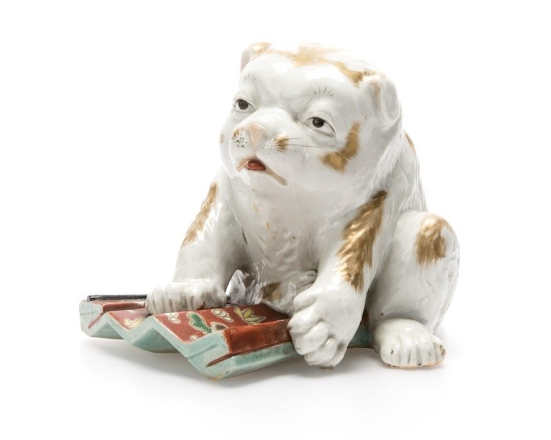A Japanese porcelain Kutani puppy