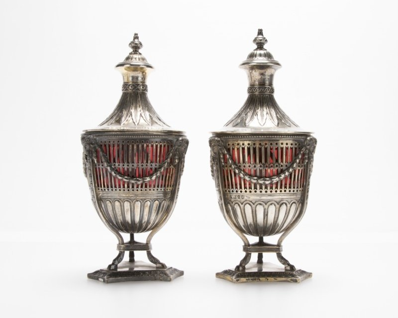 A near pair of sterling silver lidded table urns