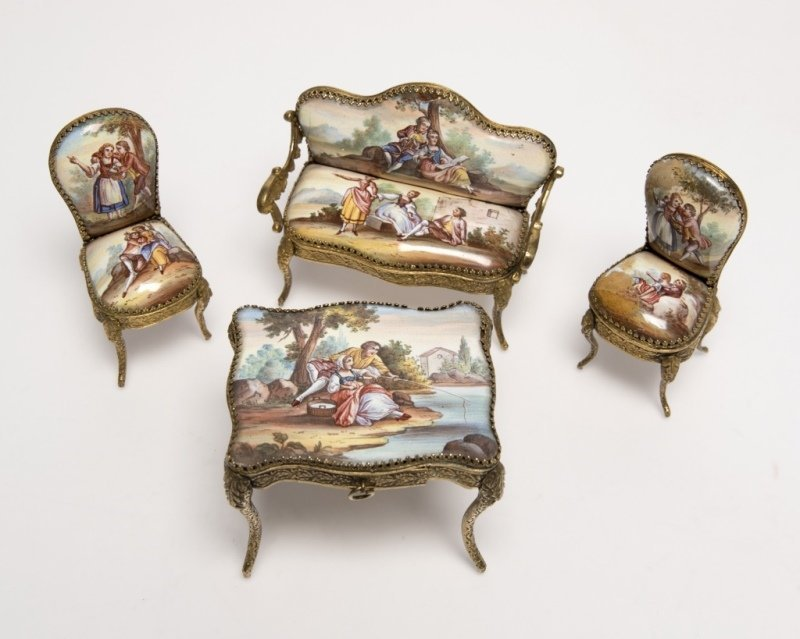 A suite of miniature enameled brass furniture