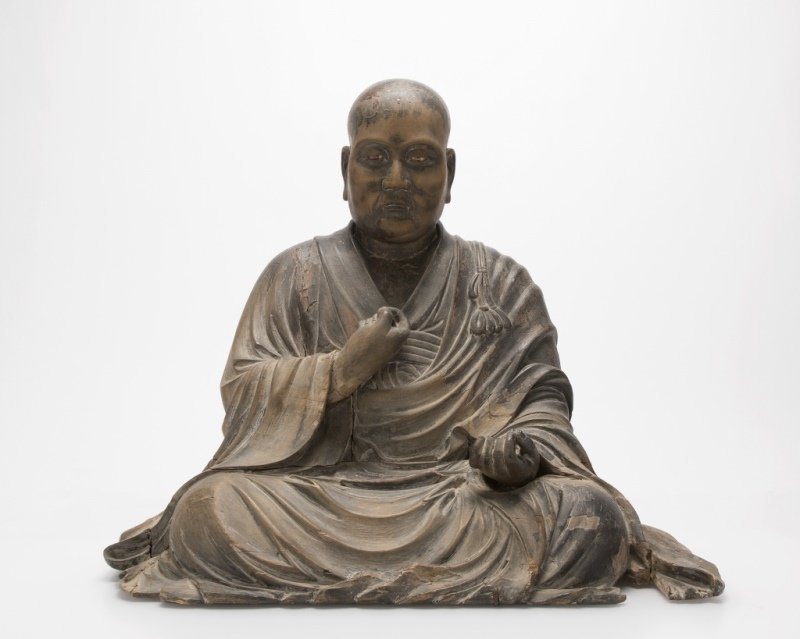 A Japanese carved wooden figure of a monk