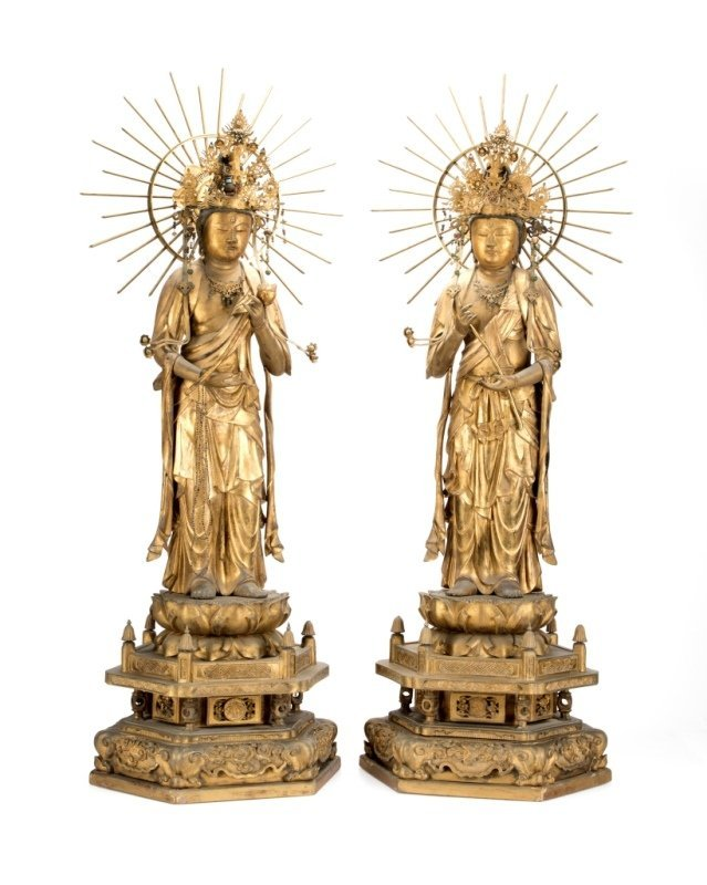 An opposing pair of carved giltwood Bodhisattva figures