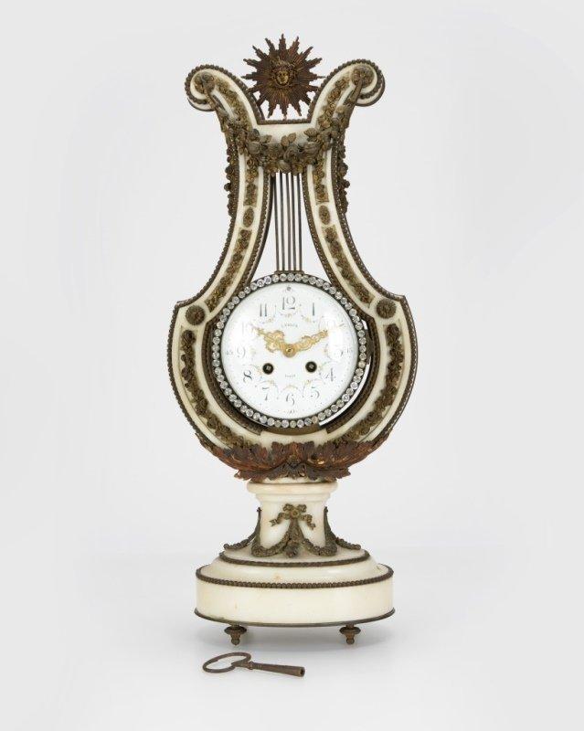 A Louis XVI-style white marble lyre clock