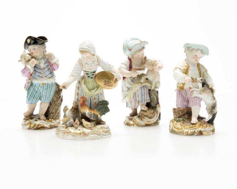 A group of Meissen porcelain figures